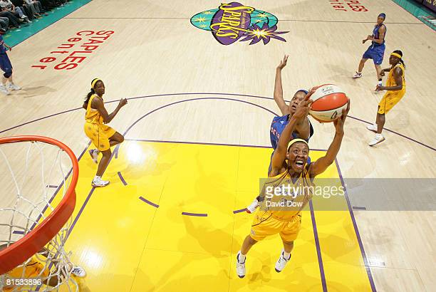Jessica Moore of the Los Angeles Sparks reaches for a rebound during the game against the Detroit Shock at Staples Center on June 11 2008 in Los...