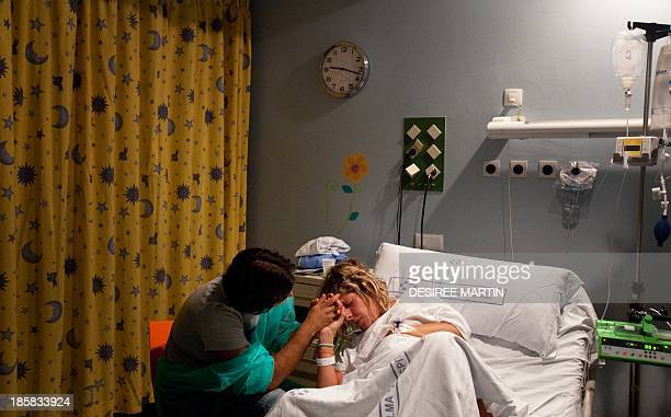 Jessica Moreno is encouraged by her partner before giving birth to their son at the University Hospital Virgen de la Candelaria of Santa Cruz de...