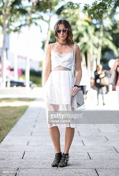 Jessica Motes is seen outside the Miami Project wearing a Timo Weiland dress Emily Cho purse Jeffrey Campbell shoes and Quay sunglasses on December 6...
