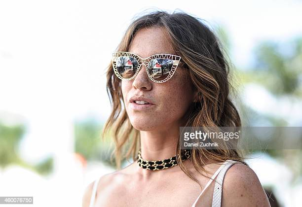 Jessica Motes is seen outside the Miami Project wearing Quay sunglasses on December 6 2014 in Miami Beach Florida