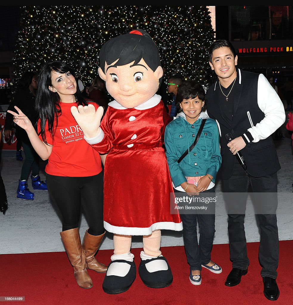 Jessica Munoz, Esperanza, Leslie Maldonado and recording artist Stefano Longone attend a special on-ice presentation to PADRES Contra El Cancer by AEG during AEG's Season of Giving celebration at the LA Kings holiday ice at Nokia Plaza L.A. LIVE on December 9, 2012 in Los Angeles, California.