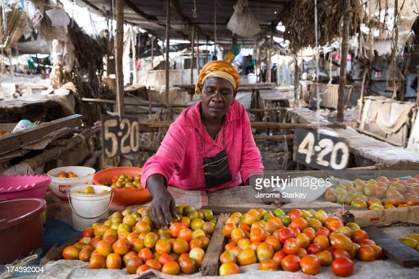 Jessica Mzinza, a tomato trader in the Kibera slum's Toi Market, in Nairobi, Kenya, March 7, 2013. She said the price of a pot of tomatoes had...