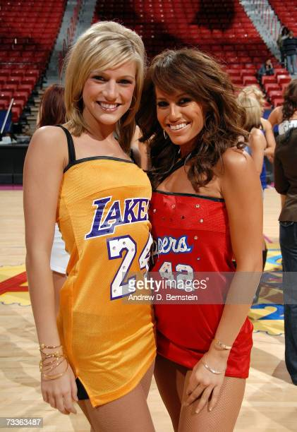 Jessica of the Los Angeles Lakers dance team and Lindsay of the Los Angeles Clippers dance team pose for a photo on the court before the start of NBA...