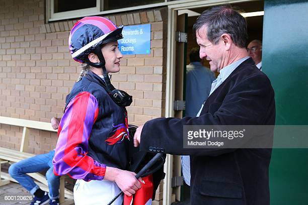 Jessica Payne listens to Brett Conlon after Total Animal Supplies Handicap at Mornington Racecourse on September 08 2016 in Mornington Australia