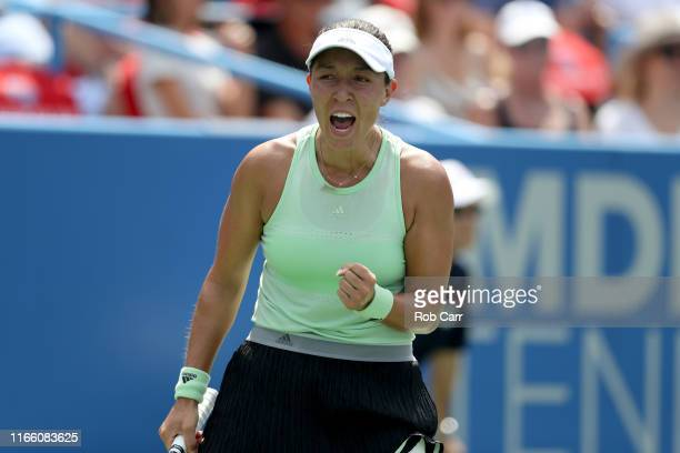 Jessica Pegula of the United States celebrates match point against Camila Giorgi of Italy during the women's singles final of the Citi Open at Rock...