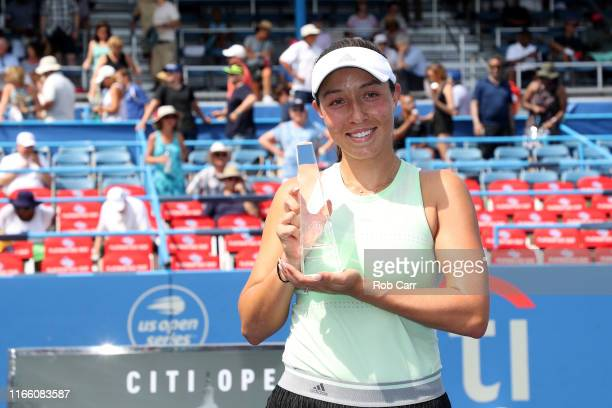 Jessica Pegula of the United States holds up the trophy after defeating Camila Giorgi of Italy during the women's singles final of the Citi Open at...
