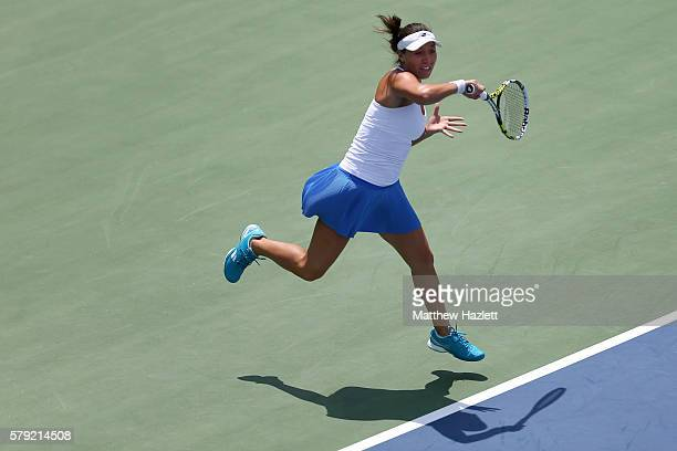 Jessica Pegula of the United States of America returns a shot to Christina Mchale of the United States of America during Day 3 of the Citi Open at...