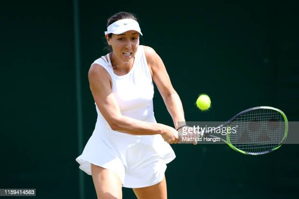 Jessica Pegula of The United States plays a backhand in her Ladies' Singles first round match against Mihaela Buzarnescu of Romania during Day one of...