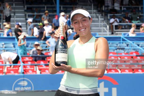 Jessica Pegula of the United States poses with champagne after defeating Camila Giorgi of Italy during the women's singles final of the Citi Open at...