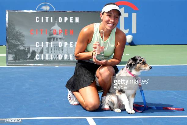 Jessica Pegula of the United States poses with her dog Maddie and the trophy after defeating Camila Giorgi of Italy during the women's singles final...