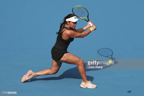 Jessica Pegula of the United States returns a shot against Naomi Osaka of Japan during women's singles first round match of 2019 China Open at the...
