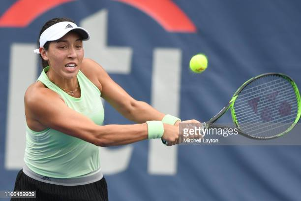 Jessica Pegula of the United States returns a shot from Iga Swiatek of Poland during Day 3 of the Citi Open at Rock Creek Tennis Center on July 31...