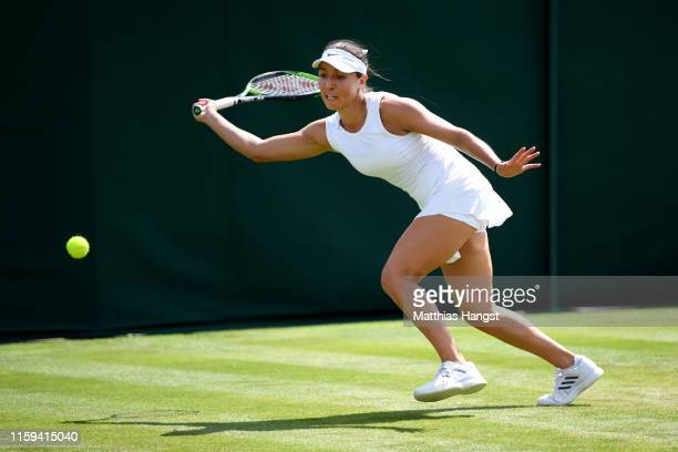 Jessica Pegula of The United States stretches to play a forehand in her Ladies' Singles first round match against Mihaela Buzarnescu of Romania...