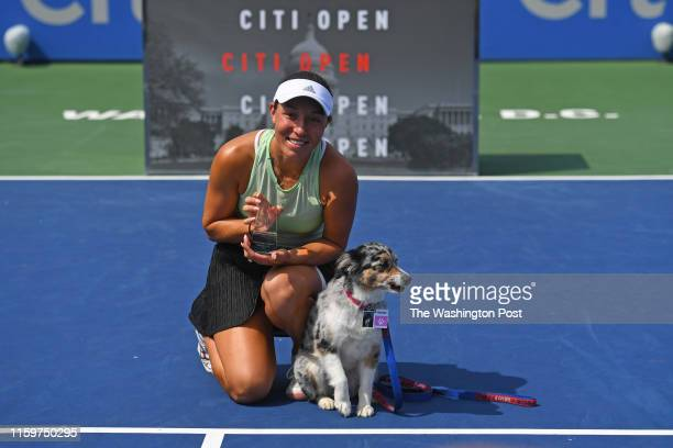 Jessica Pegula of the US poses with the trophy and her dog Maddie after beating Camila Giorgi of Italy 62 62 at Rock Creek Tennis Center to win the...