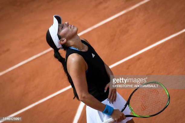 Jessica Pegula of the US reacts as she plays against Australia's Ashleigh Barty during their women's singles first round match on day two of The...