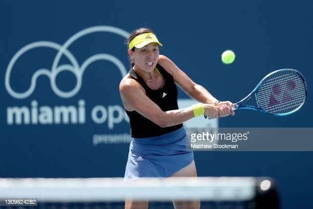 Jessica Pegula returns a shot to Karolina Pliskova of Czech Republic during the Miami Open at Hard Rock Stadium on March 28, 2021 in Miami Gardens,...