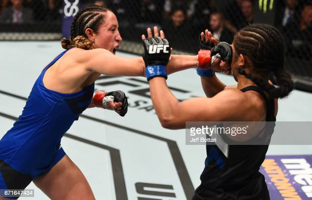 Jessica Penne punches Danielle Taylor in their women's strawweight bout during the UFC Fight Night event at Bridgestone Arena on April 22 2017 in...
