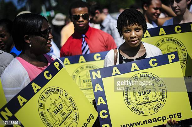 Jessica Pickens of Chicago, IL stands with fellow voting rights activists outside the U.S. Supreme Court on Tuesday, June 25 in Washingto, DC, the...