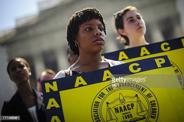 Jessica Pickens of Chicago IL stands with fellow voting rights activists outside the US Supreme Court on Tuesday June 25 in Washingto DC the day the...