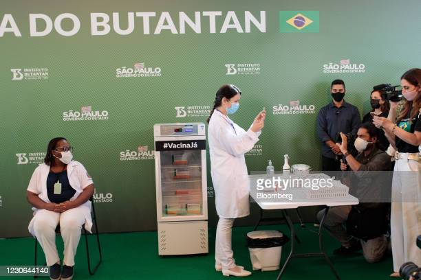Jessica Pires de Camargo, master of public health at Santa Casa de Sao Paulo, right, prepares the first Sinovac Biotech Covid-19 vaccination for...