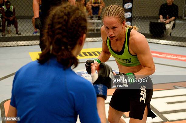 Jessica Rakoczy attacks Roxanne Modafferi in their preliminary fight during filming of season eighteen of The Ultimate Fighter on June 12 2013 in Las...