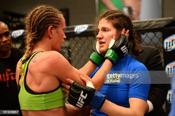 Jessica Rakoczy consoles Roxanne Modafferi after their preliminary fight during filming of season eighteen of The Ultimate Fighter on June 12 2013 in...