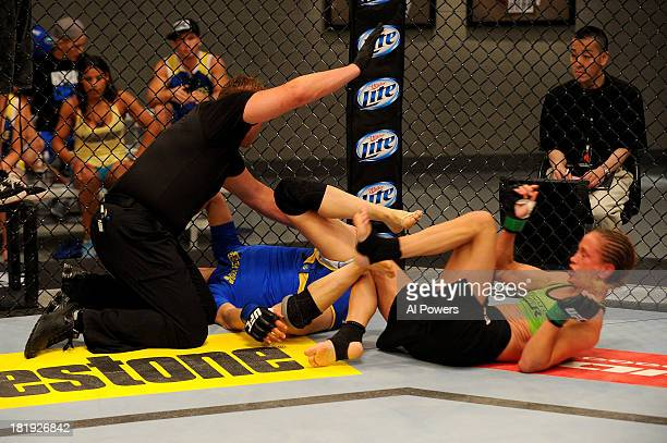 Jessica Rakoczy is pulled off Roxanne Modafferi in their preliminary fight during filming of season eighteen of The Ultimate Fighter on June 12 2013...