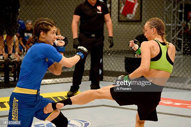Jessica Rakoczy kicks Roxanne Modafferi in their preliminary fight during filming of season eighteen of The Ultimate Fighter on June 12 2013 in Las...