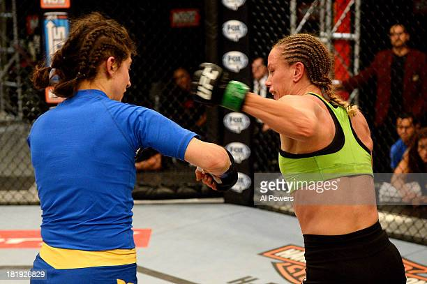 Jessica Rakoczy punches Roxanne Modafferi in their preliminary fight during filming of season eighteen of The Ultimate Fighter on June 12 2013 in Las...