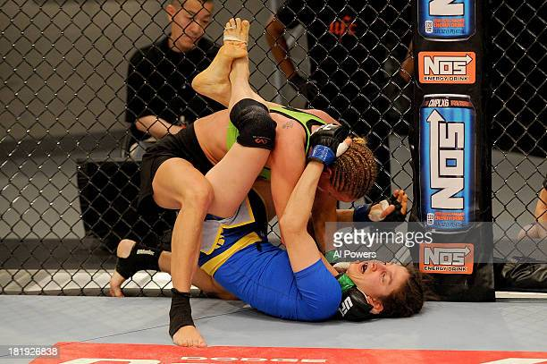 Jessica Rakoczy takes down Roxanne Modafferi in their preliminary fight during filming of season eighteen of The Ultimate Fighter on June 12 2013 in...