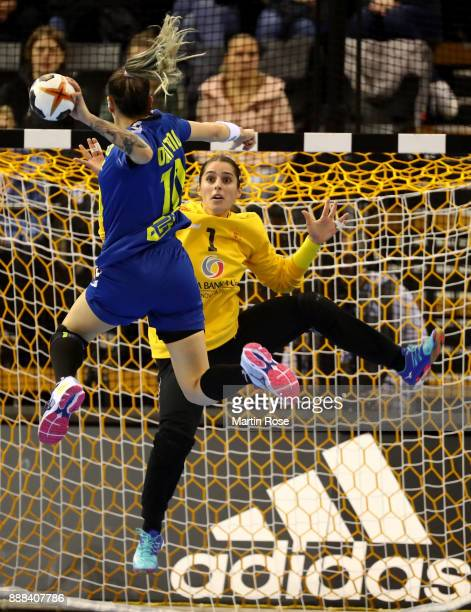 Jessica Ribeiro of Brazil scotres a goal over Marina Rajcic goalkeeper of Montenegro during the IHF Women's Handball World Championship group C match...