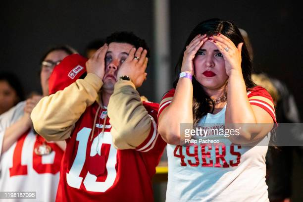 Jessica Rodriguez and her husband Tony Rodriguez of Concord, California react while watching the San Francisco 49ers play the Kansas City Chiefs...