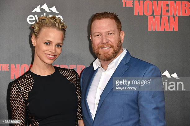 Jessica Roffey and Ryan Kavanaugh arrive at The November Man Los Angeles Premiere at TCL Chinese Theatre on August 13 2014 in Hollywood California