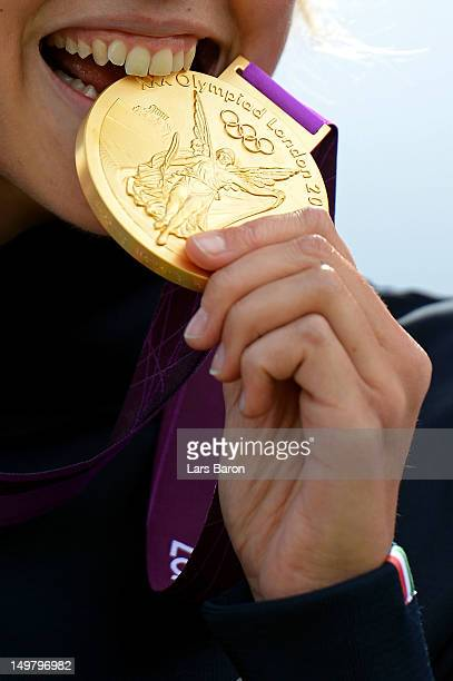 Jessica Rossi of Italy bites the gold medal on the podium during the medal ceremony for the Women's Trap Shooting Finals on Day 8 of the London 2012...