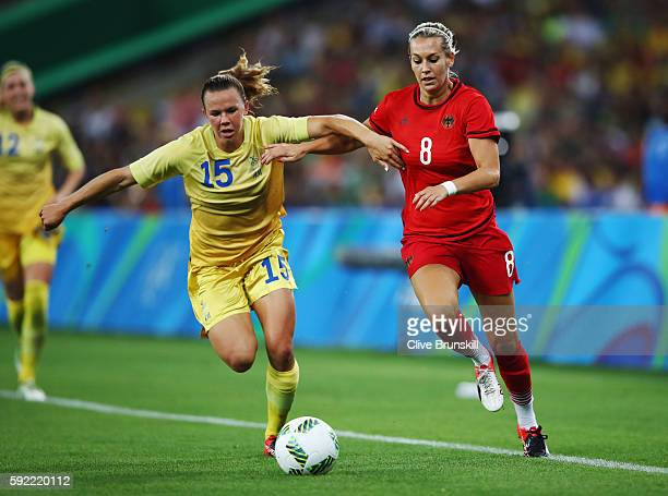 Jessica Samuelsson of Sweden challenges Lena Goessling of Germany during the Women's Olympic Gold Medal match between Sweden and Germany at Maracana...