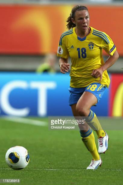 Jessica Samuelsson of Sweden runs with the ball during the UEFA Women's EURO 2013 Group A match between Sweden and Denmark at Gamla Ullevi Stadium on...
