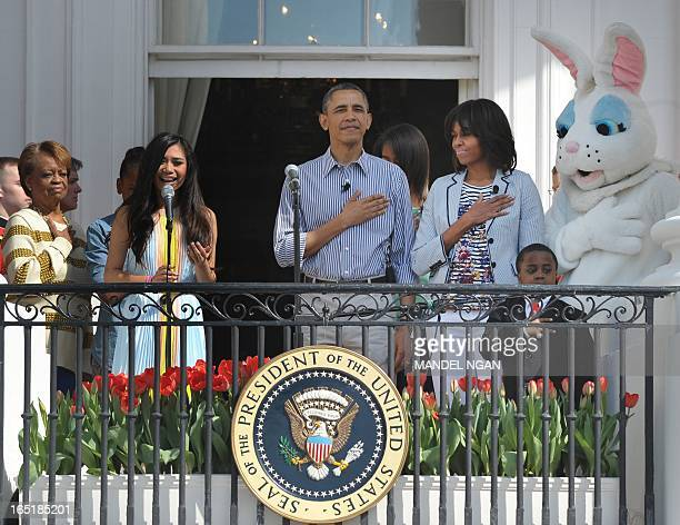 Jessica Sanchez performs the National Anthem at the start of the annual Easter Egg Roll on April 1 2013 at the White House in Washington DC Watching...