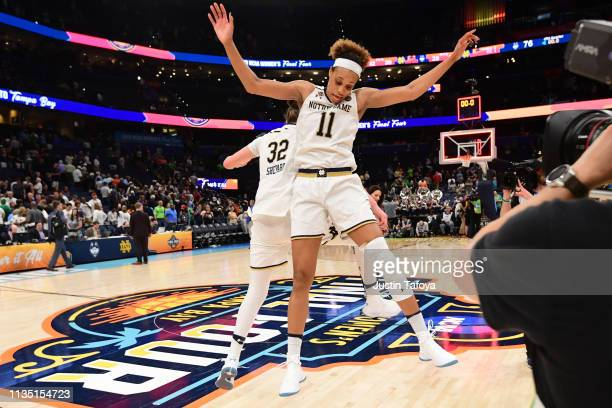 Jessica Shepard and Brianna Turner of the Notre Dame Fighting Irish players react to beating the Connecticut Huskies at Amalie Arena on April 5 2019...
