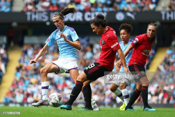Jessica Sigsworth of Manchester United and Jill Scott of Manchester City battle for possession during the Barclays FA Women's Super League match...