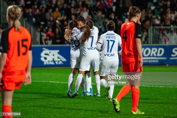 Jessica Silva of Olympique Lyonnais celebrates with her teammates after scoring a goal during the UEFA Women's Champions League round of 16 match...
