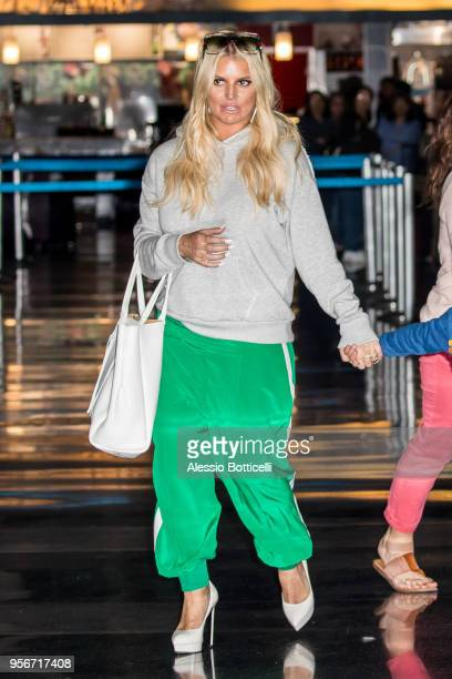 Jessica Simpson and Eric Johnson are seen at JFK Airport on May 9 2018 in New York New York