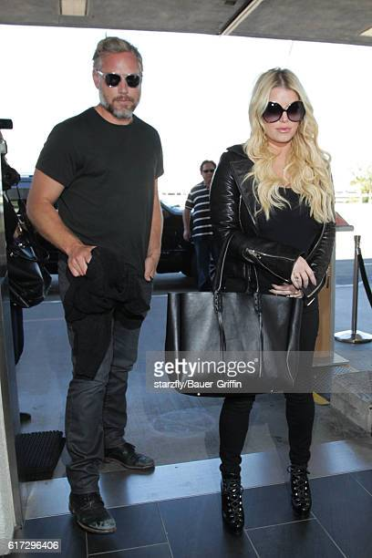 Jessica Simpson and Eric Johnson are seen at LAX on October 22 2016 in Los Angeles California
