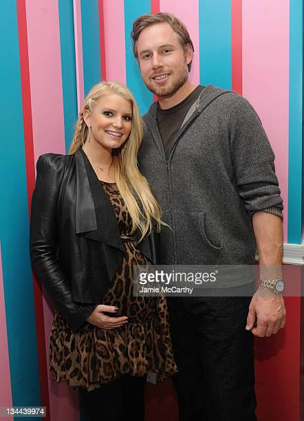 Jessica Simpson and Eric Johnson attend the launch of Jessica Simpson Girls at Dylan's Candy Bar on December 1 2011 in New York City