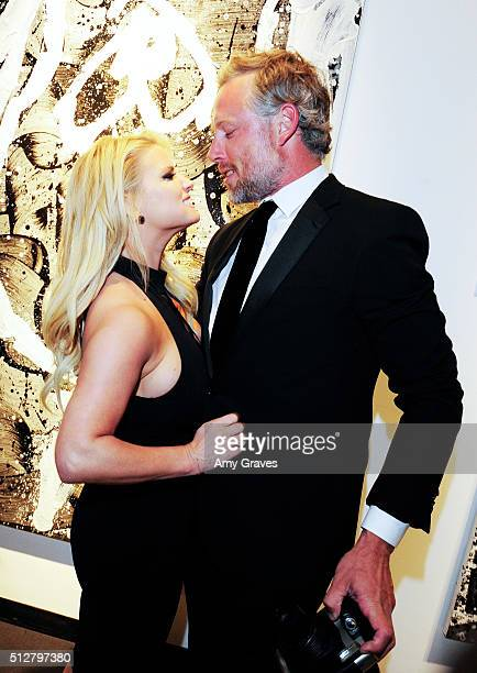 Jessica Simpson and Eric Johnson attend the Tom Everhart Raw Exhibition of His Schulzinfluenced Paintings For The First Time In Black And White At...