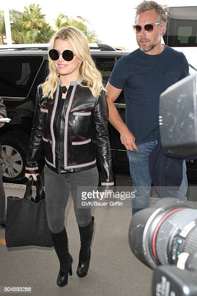 Jessica Simpson and Eric Johnson is seen at LAX on January 11 2016 in Los Angeles California