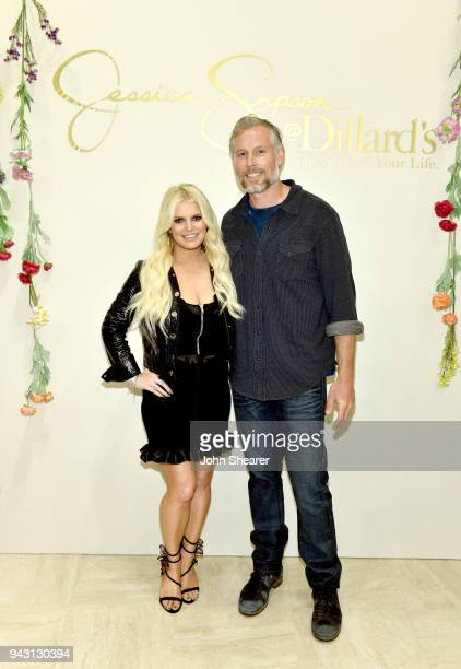 Jessica Simpson and Eric Johnson take photos during a spring style event in Dillards at The Mall at Green Hills hosted by Jessica Simpson on April 7...