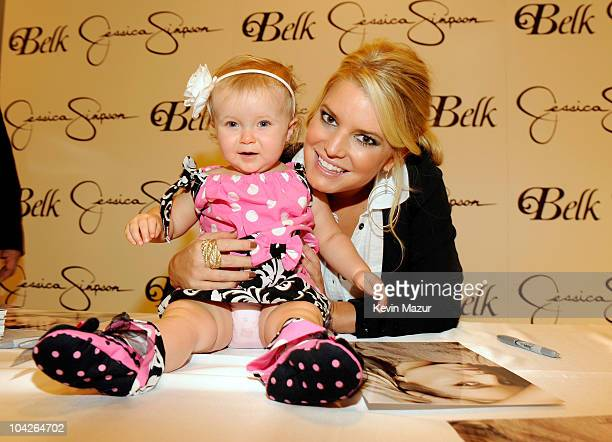Jessica Simpson and fan Presley Tucker attend Jessica Simpson Collection InStore Appearance event at Belk Southpark Mall on September 18 2010 in...