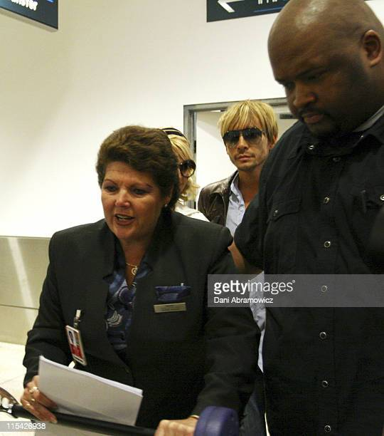 Jessica Simpson and hair stylist Ken Paves during Jessica Simpson Sighting at Sydney International Airport April 10 2006 at Sydney International...