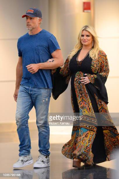 Jessica Simpson and husband Eric Johnson seen at JFK Airport on September 18 2018 in New York City