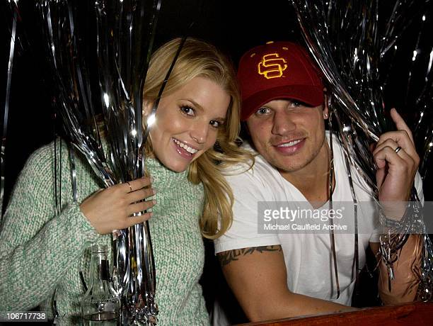 Jessica Simpson and Nick Lachey during Smirnoff Ice Triple Black Hosts an 80's Roller Skating Holiday Party at the Moonlight Rollerway in Los Angeles...